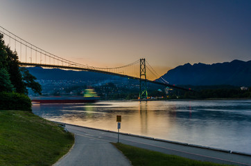 Lions Gate Bridge at Sunset with a Passing Ship
