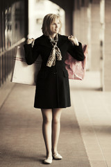 Young fashion woman with shopping bags in the mall
