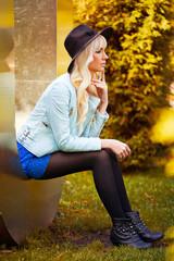 Beautiful blonde model in dress outdoors