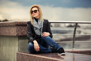 Portrait of happy young fashion woman outdoor
