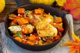 the baked chicken with pumpkin in a pig-iron frying pan