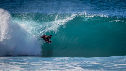 Bodyboarder in the tube