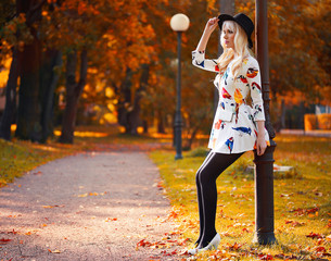 Beautiful blonde girl in dress outdoors
