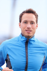 Man running outdoors closeup in fall in jacket