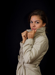 Portrait of beautiful young girl in raincoat