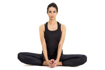 Pretty young woman training yoga