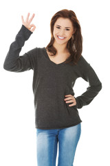 Happy woman with perfect hand sign