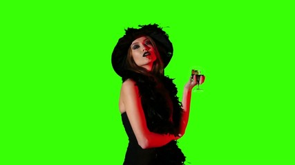 Halloween witch with a glass of blood on green screen