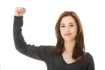 Young woman showing her strength