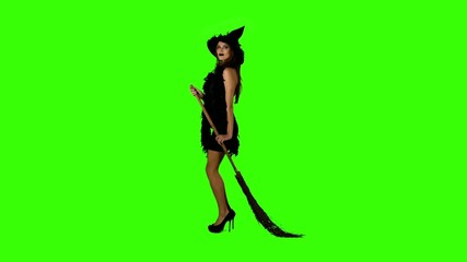 Halloween witch with a broom  on green screen