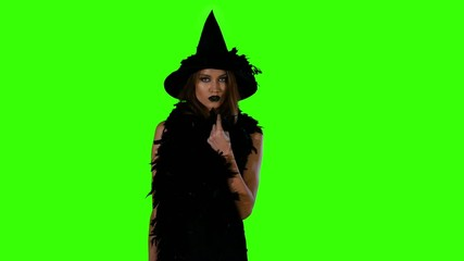 Halloween witch with a black scarf  on green screen