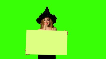 Halloween redheaded witch with a green sign. Halloween.