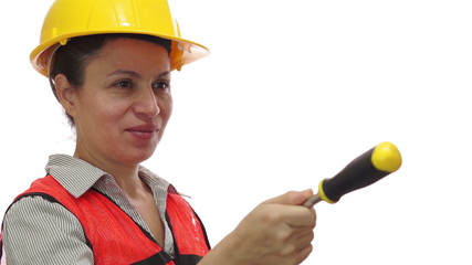 Smiling Female Worker Passing Screwdriver