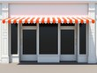 Shopfront with two doors in the sun - classic store front with