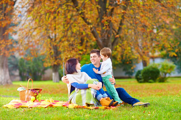 happy family together on autumn picnic