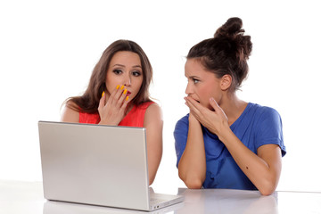 Two young women are shocked by the computer contents