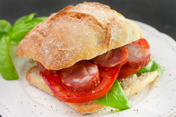 bread with chourico, basil and tomato