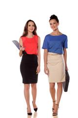 two young business women walking