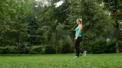 Fitness exercise woman using dumbbells in fitness strength