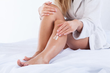Woman using body cream