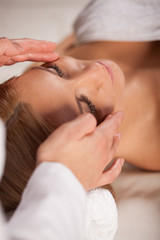 Woman relaxing during face massage