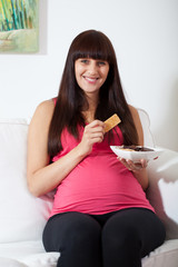 Woman eating sweets during pregnancy