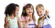 happy kids eating ice cream in studio isolated - 71345488