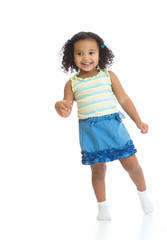Kid girl standing or dancing full length isolated