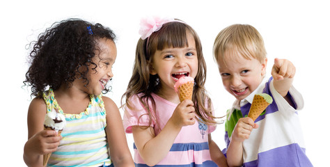 happy kids eating ice cream in studio isolated