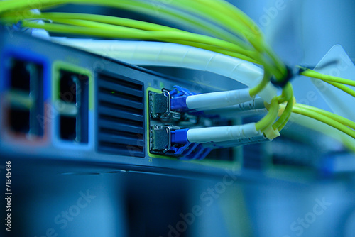 Leinwanddruck Bild network optical fiber cables and hub