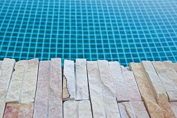 Water in swimming pool with stone