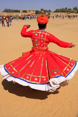 Indian man in traditional dress dancing at Desert Festival, Jais