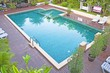Swimming pool and garden at resort - 71346402