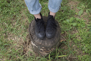 Woman standing on top of the stump