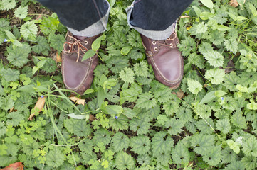 Feet of a man standing on top of the weed