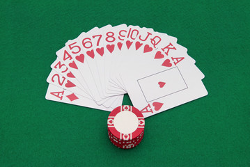 cards and chips on green casino table