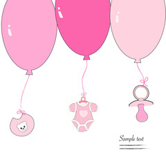 Hanging baby clothing symbols with ballons