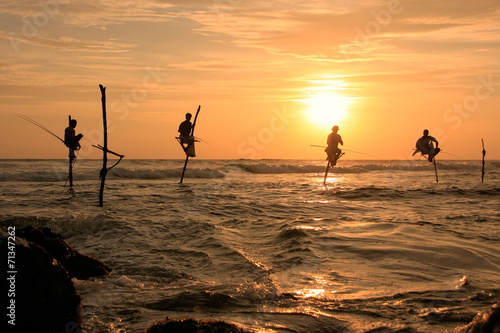 Deurstickers Overige Silhouette of a stick fishermen at sunset, Unawatuna, Sri Lanka