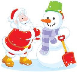 Santa making a snowman