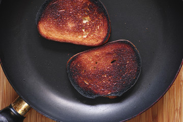 Too much roasted toast on a frying pan