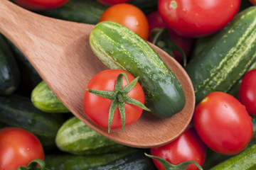 Tomato and cucumber in a wooden spoon