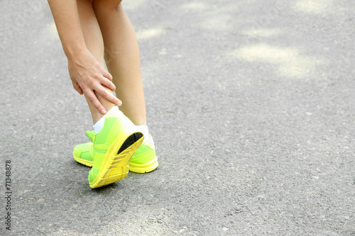canvas print picture Sports injuries of girl outdoors