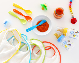 Baby carrot puree, spoons and bibs