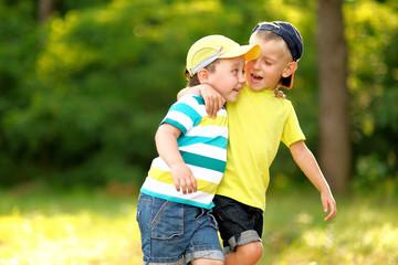 portrait of two little boys friends  in summer