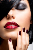 Face of a woman with beautiful dark nails and sexy red lips - 71350469
