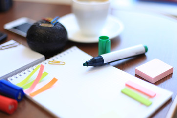 blank sheet and stationeries with cup of coffee on the table