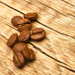 Coffee beans on old wooden table - 1 to 1 ratio