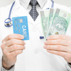 Doctor holding money and credit card - 1 to 1 ratio