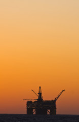 Oil platform silhouette in gulf of mexico