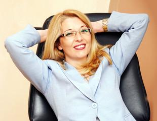 Businesswoman in glasses gesture